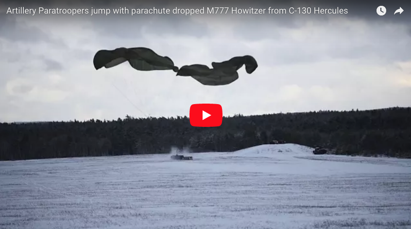 Artillery Paratroopers jump with parachute dropped M777 Howitzer from C-130 Hercules